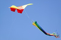 Rainbow colors of a kite flying in a deep blue sky on April 15, 2007, at the Santa Barbara Kite Festival, Santa Barbara City College, overlooking Paci...