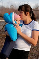 Young mother walks in the park with your child