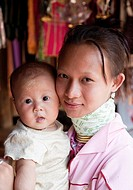 Woman from the Kayan minority group with her baby, Huai Seau Tao, Mae Hong Son Province, Thailand
