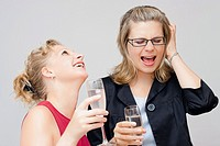 Two young women enjoying party