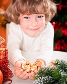 Funny child holding cookies