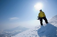 Snowboarder in front of sun
