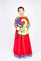 Girl in Korean traditional dress holding folding fan, Hanbok, cheongsachorong
