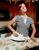 Housewife Ironing Money