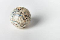 Close_up of globe on white background