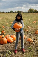 Girl in pumpkin field