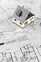 Mini house on blueprint