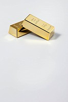 Two gold bar on white background