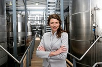 Portrait of business woman in factory