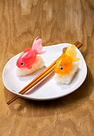 Plate of sushi with toy fish