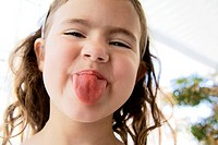 Little girl stinking at tongue