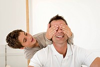 Son 12_13 covering father´s eyes