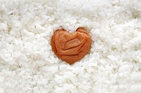 A heartshaped pickled plum in rice