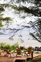 Deck with chairs, overlooking ocean