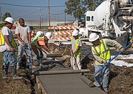 New Orleans, Louisiana - A construction crew rebuilds streets and sidewalks in the lower ninth ward, seven years after the area was devastated by Hurr...
