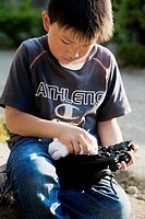 boy holding a glove