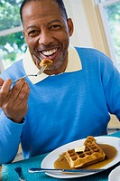 Portrait of a senior man having breakfast