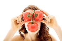 Woman Holding Bunch of Tomatoes in Front of Face