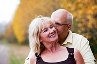 Mature married couple enjoying spending time together in park during fall season, edmonton, alberta, canada