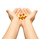 Woman holding a pile of pills