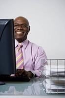 Close_up of a businessman using a computer and smiling