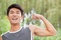 Chinese man flexing muscles