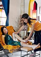 A woman receives a Reflexology Massage