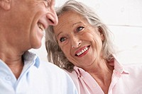 Spain, Senior couple looking at each other, smiling (thumbnail)