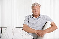 Spain, Mallorca, Sad senior man sitting on couch