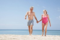 Spain, Mallorca, Senior couple walking on beach