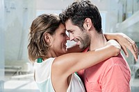 Spain, Mid adult couple embracing, smiling