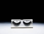 False eyelashes in case, close_up