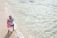 Spain, Senior couple standing beach