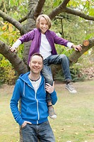 Germany, Leipzig, Father and son having fun, smiling, portrait