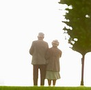 Artificial old couple are standing nestling close to each other.