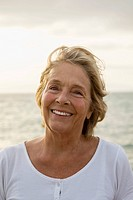 Spain, Senior woman at the sea, smiling