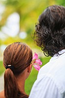 The back of the heads of a man and woman the woman having a flower in her hair bora bora nui resort and spa, bora bora island society islands french p...