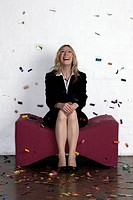 Businesswoman laughing with confetti