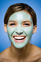 Woman with facial mask smiling