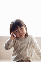 Little girl using mobile phone,smiling