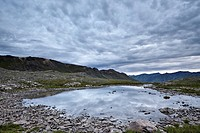Clouds reflected in a tarn at Stony Pass, San Juan National Forest, Colorado, United States of America, North America