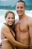 Couple embracing at beach smiling