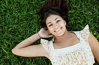 retty, happy woman laying in grass