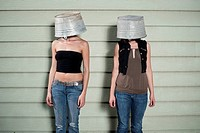 Two Young Woman Wearing Buckets
