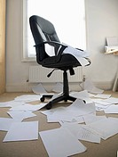 Office covered in discarded work papers