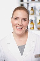 Brunette female pharmacist in laboratory