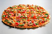 Thin crust pizza sliced in squares