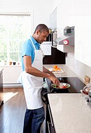Man cooking at stovetop