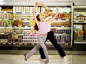 Couple Dancing in Supermarket