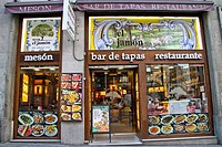 Traditional tile work or Azulejos on the facade on a Tapas bar in Gran Via street, Madrid, Spain